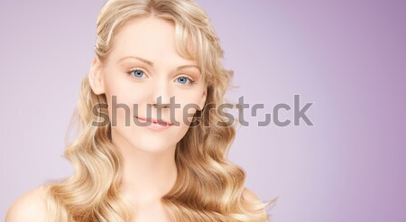 beautiful young woman face with long wavy hair Stock photo © dolgachov
