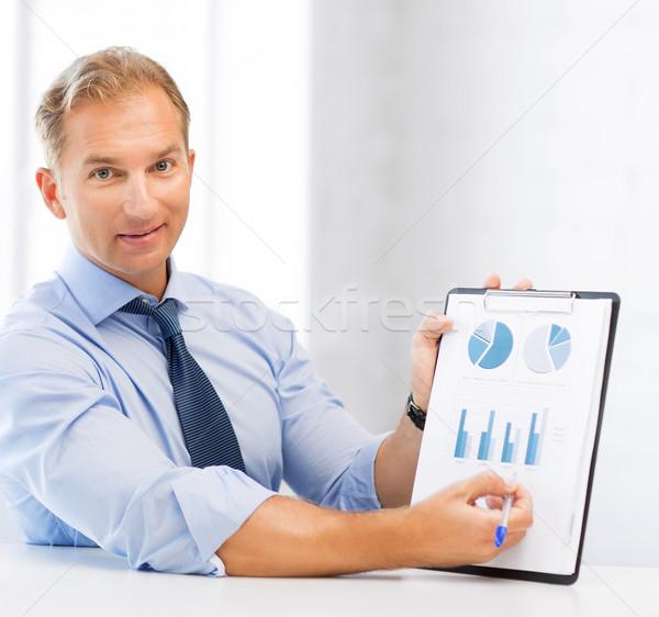 businessman showing graphs and charts Stock photo © dolgachov