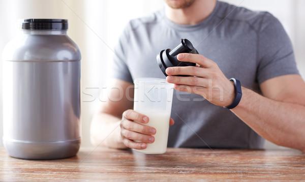 男 タンパク質 ぶれ ボトル jarファイル ストックフォト © dolgachov