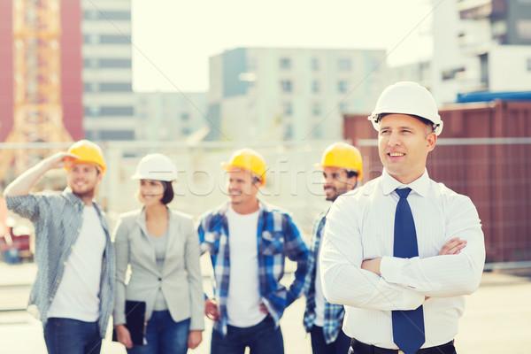 グループ 笑みを浮かべて ビルダー 屋外 ビジネス 建物 ストックフォト © dolgachov