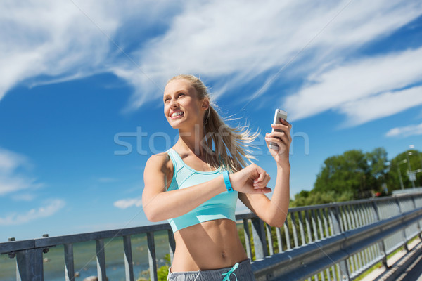 happy woman with heart rate watch and smartphone Stock photo © dolgachov