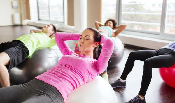 Boldog emberek abdominális izmok fitnessz sport képzés Stock fotó © dolgachov