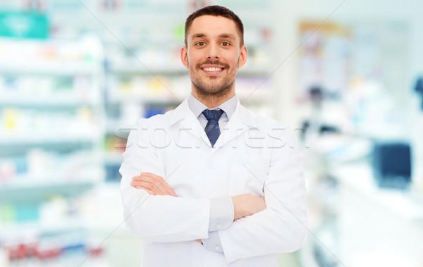 笑みを浮かべて 男性 薬剤師 白 コート ドラッグストア ストックフォト © dolgachov