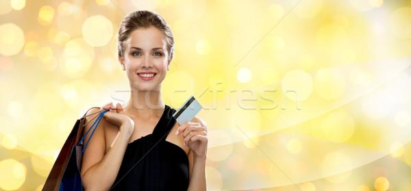 Stockfoto: Glimlachende · vrouw · plastic · kaart · winkelen · verkoop