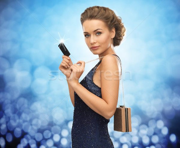 beautiful woman in evening dress with vip card Stock photo © dolgachov