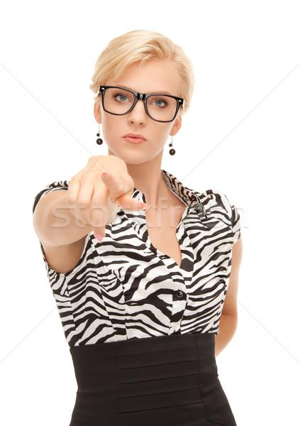 businesswoman pointing her finger Stock photo © dolgachov