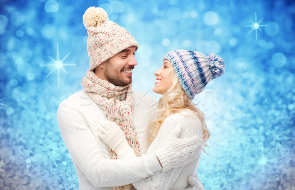 happy couple in winter clothes hugging over lights Stock photo © dolgachov