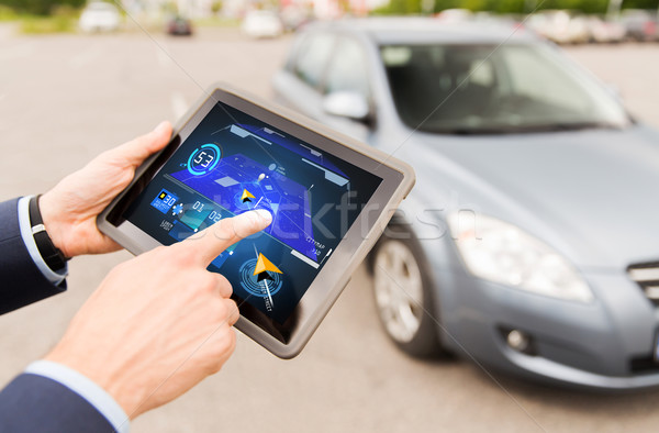 male hands with navigator on tablet pc and car Stock photo © dolgachov