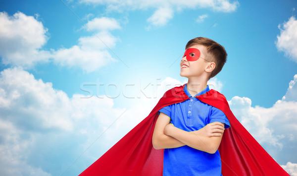 Fiú piros szuperhős maszk karnevál gyermekkor Stock fotó © dolgachov