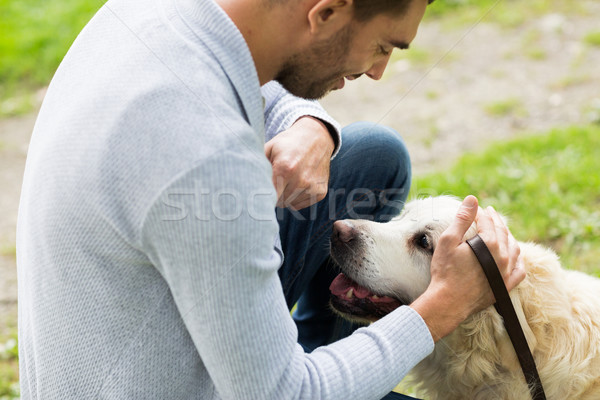 close up of man with labrador dog outdoors Stock photo © dolgachov