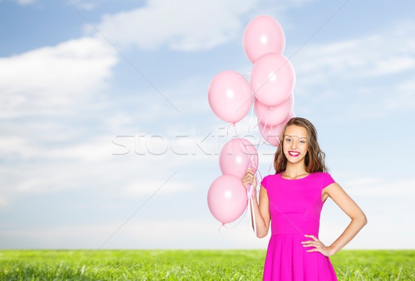 happy young woman or teen with helium air balloons Stock photo © dolgachov