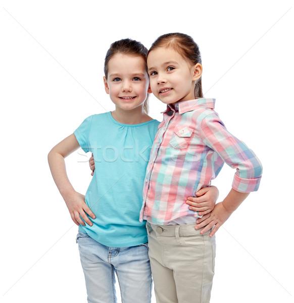 Boldog mosolyog kislányok ölel gyermekkor divat Stock fotó © dolgachov