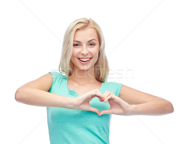 happy woman or teen girl showing heart shape sigh Stock photo © dolgachov