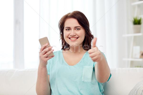 Plus size kobieta smartphone ludzi Zdjęcia stock © dolgachov