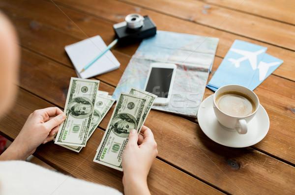 close up of traveler hands counting dollar money Stock photo © dolgachov