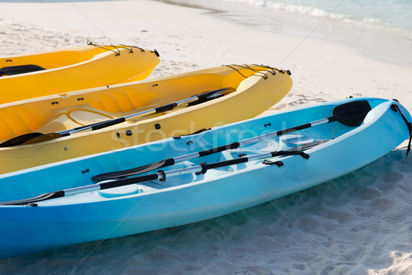 canoes or kayaks on sandy beach Stock photo © dolgachov