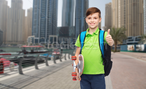 boy with backpack and skateboard showing thumbs up Stock photo © dolgachov
