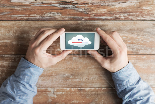 close up of hands with smartphone cloud computing Stock photo © dolgachov