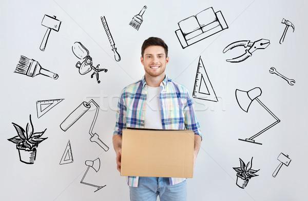 笑みを浮かべて 若い男 ホーム 移動 住宅 ストックフォト © dolgachov