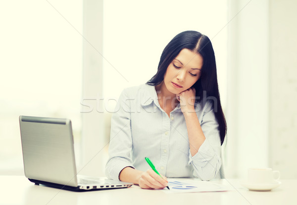 tired businesswoman or student with laptop Stock photo © dolgachov