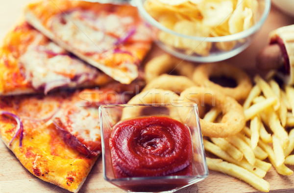 close up of fast food snacks on wooden table Stock photo © dolgachov