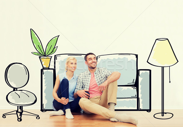 happy couple of man and woman moving to new home Stock photo © dolgachov