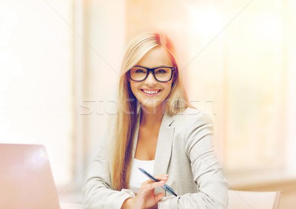 businesswoman with pen Stock photo © dolgachov