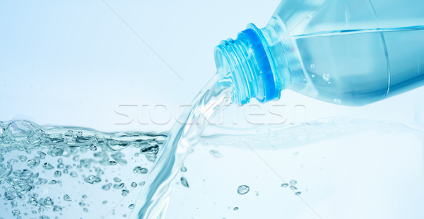 close up of water pouring from plastic bottle Stock photo © dolgachov