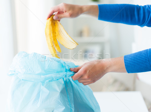close up of hand putting food waste to rubbish bag Stock photo © dolgachov