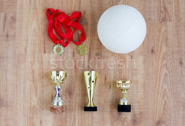 close up of volleyball ball, cups and medals Stock photo © dolgachov