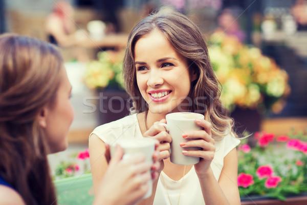 Сток-фото: улыбаясь · кофейные · чашки · кафе · связи · дружбы