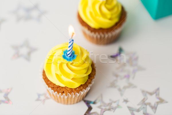 birthday cupcakes with burning candles Stock photo © dolgachov
