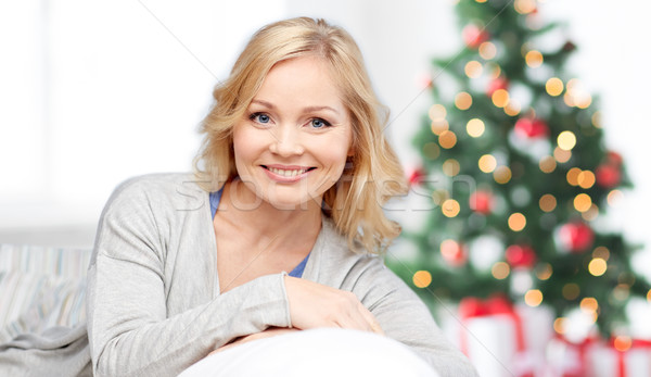 happy middle aged woman at christmas Stock photo © dolgachov