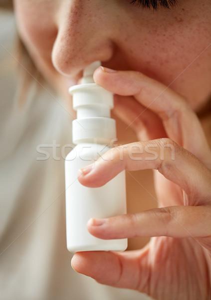 close up of sick woman using nasal spray Stock photo © dolgachov