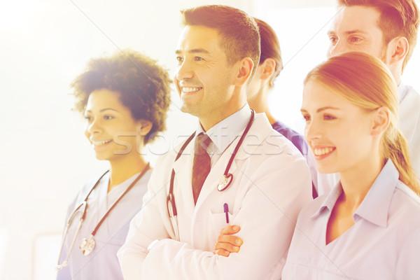 Csoport boldog orvosok kórház hivatás emberek Stock fotó © dolgachov