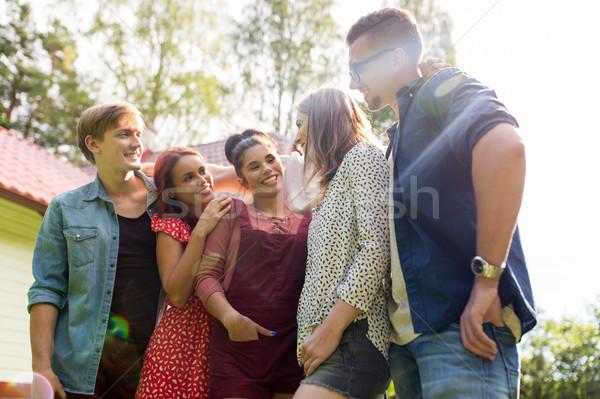 happy teenage friends hugging at summer garden Stock photo © dolgachov