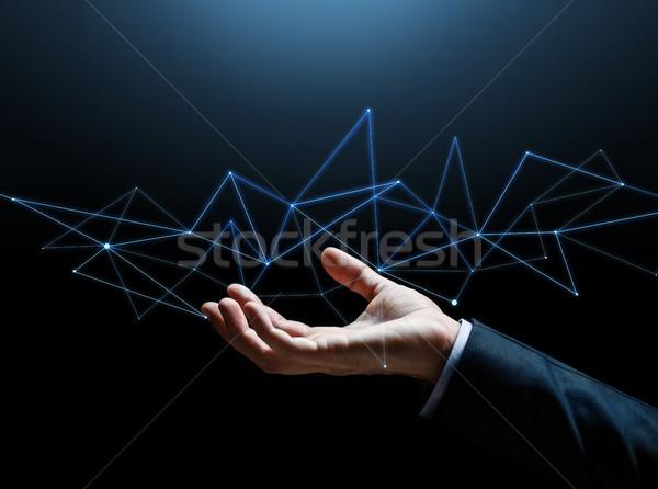 Empresário mão holograma pessoas de negócios ciberespaço Foto stock © dolgachov