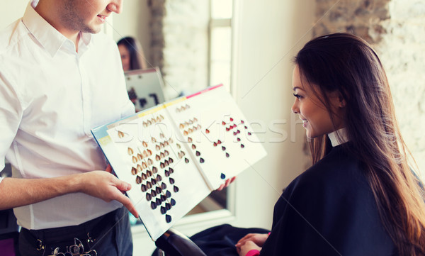 woman choosing hair color from palette at salon Stock photo © dolgachov