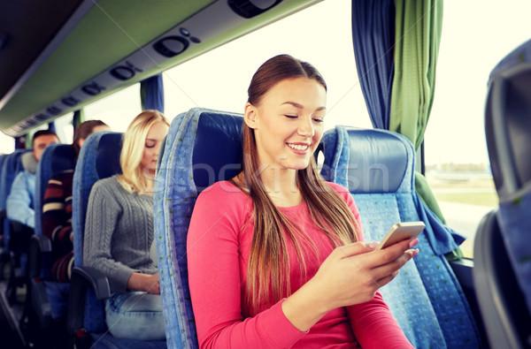Mutlu kadın oturma seyahat otobüs Stok fotoğraf © dolgachov