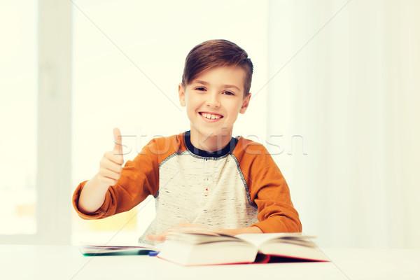 Feliz estudiante nino libro de texto Foto stock © dolgachov