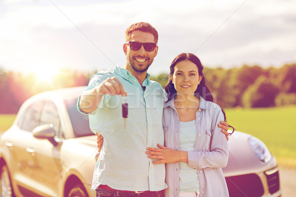 happy man and woman with car key hugging  Stock photo © dolgachov