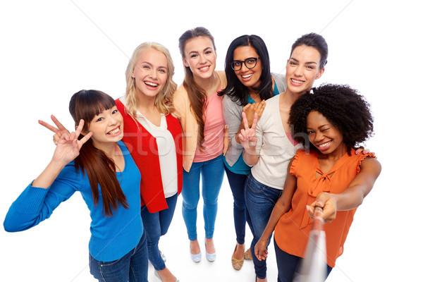 international group of women with selfie stick Stock photo © dolgachov