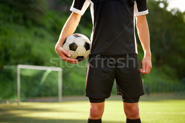 soccer player with ball on football field Stock photo © dolgachov