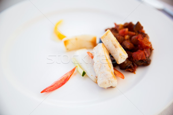 white fish with stewed eggplant garnish on plate Stock photo © dolgachov