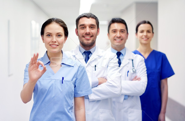 Grupy szczęśliwy lekarzy szpitala kliniki zawód Zdjęcia stock © dolgachov