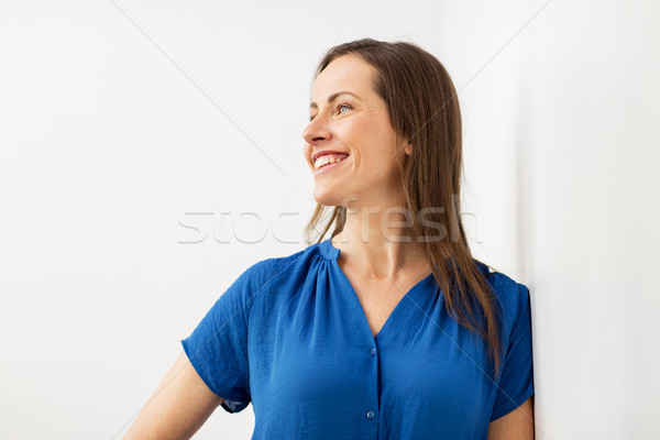 happy smiling middle aged woman Stock photo © dolgachov