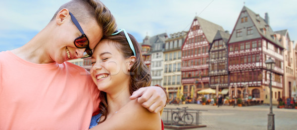 happy teenage couple hugging in frankfurt city Stock photo © dolgachov