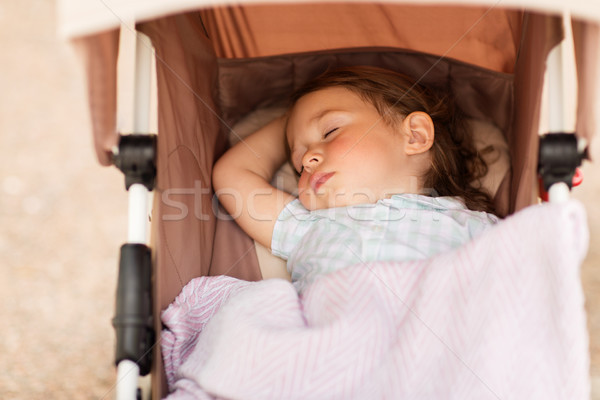 little child or baby sleeping in stroller outdoors Stock photo © dolgachov