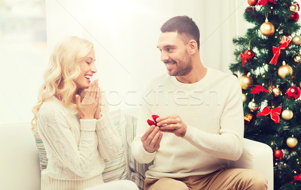 man giving woman engagement ring for christmas Stock photo © dolgachov