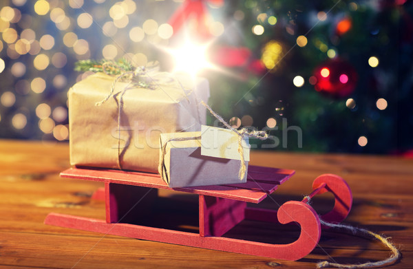 close up of christmas gift boxes on wooden sleigh Stock photo © dolgachov